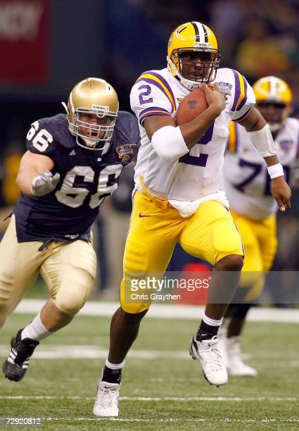 Quarterback JaMarcus Russell of the LSU Tigers carries the ball in the first quarter past Derek Landri of the Notre Dame Fighting Irish in the 2007...