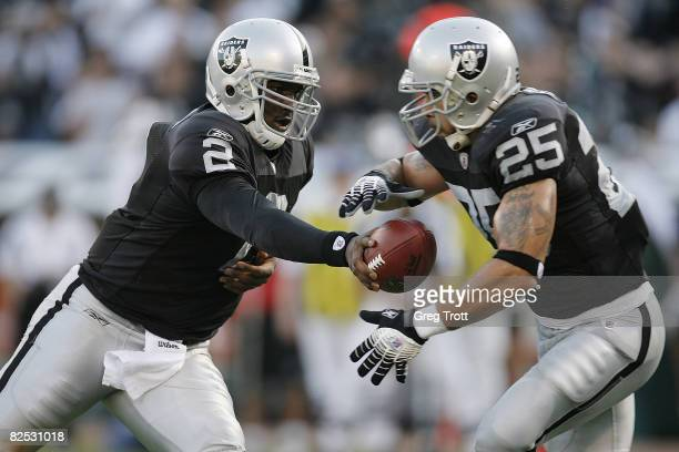 Quarterback JaMarcus Russell of the Oakland Raiders hands off to running back Justin Fargas against the Arizona Cardinals during a preseason game on...