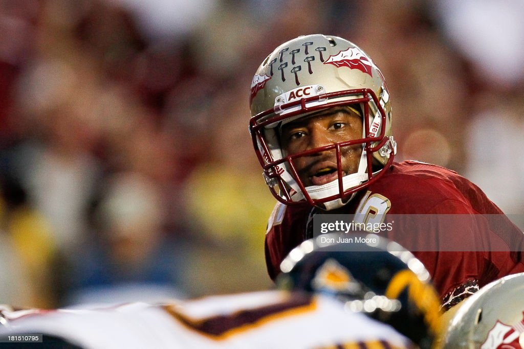 Quarterback <a gi-track='captionPersonalityLinkClicked' href=/galleries/search?phrase=Jameis+Winston&family=editorial&specificpeople=8772860 ng-click='$event.stopPropagation()'>Jameis Winston</a> #5 of the Florida State Seminoles calls a play at the line of scrimmage during the game against the Bethune-Cookman Wildcats at Doak Campbell Stadium on Bobby Bowden Field on September 21, 2013 in Tallahassee, Florida. The 8th ranked Florida State Seminoles defeated the Bethune-Cookman Wildcats 54-6.