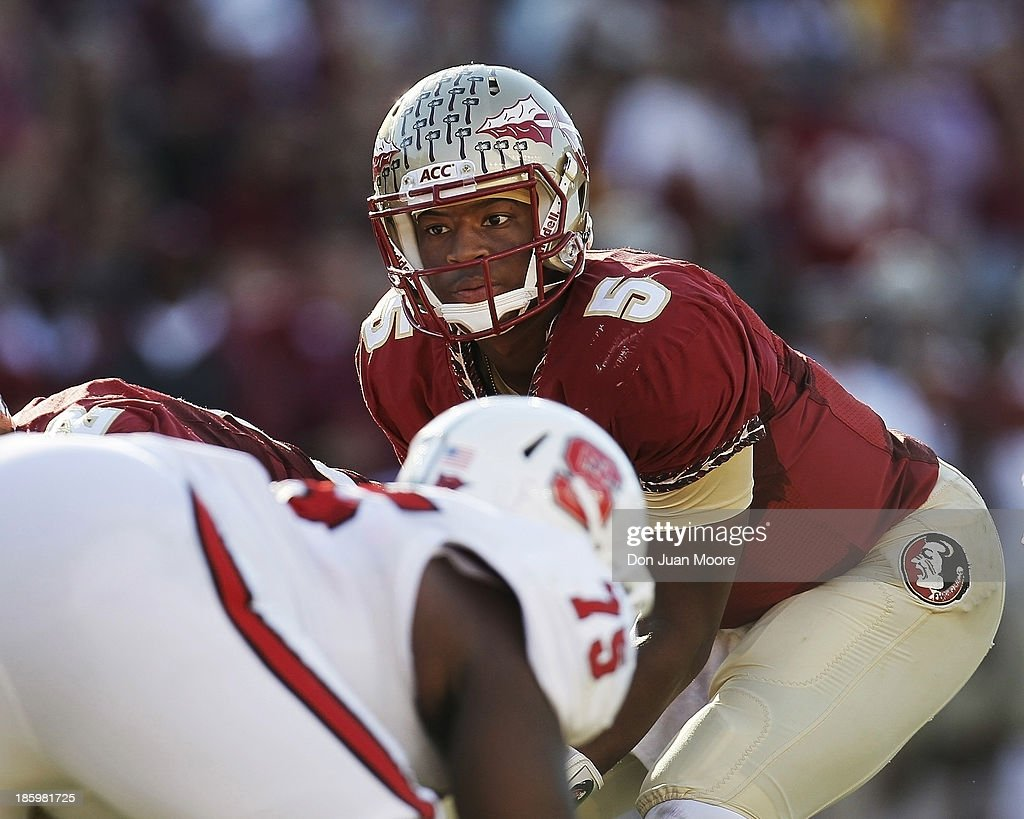 Quarterback <a gi-track='captionPersonalityLinkClicked' href=/galleries/search?phrase=Jameis+Winston&family=editorial&specificpeople=8772860 ng-click='$event.stopPropagation()'>Jameis Winston</a> #5 of the Florida State Seminoles calls a play during the game against North Carolina State Wolfpack at Bobby Bowden Field at Doak Campbell Stadium on October 26, 2013 in Tallahassee, Florida. The 3rd ranked Florida State Seminoles defeated North Carolina State Wolfpack 49-17.