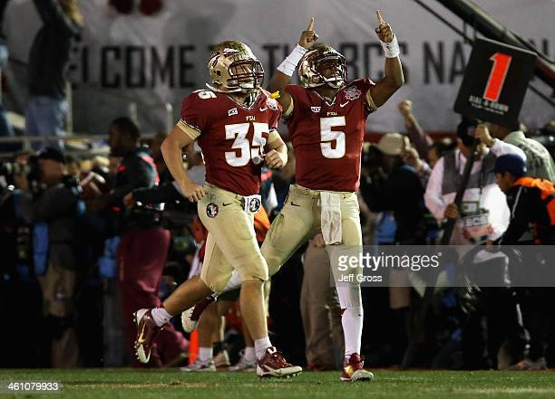 Quarterback Jameis Winston of the Florida State Seminoles celebrates after a 2yard touchdown to take a 3331 lead in the final moments of the fourth...