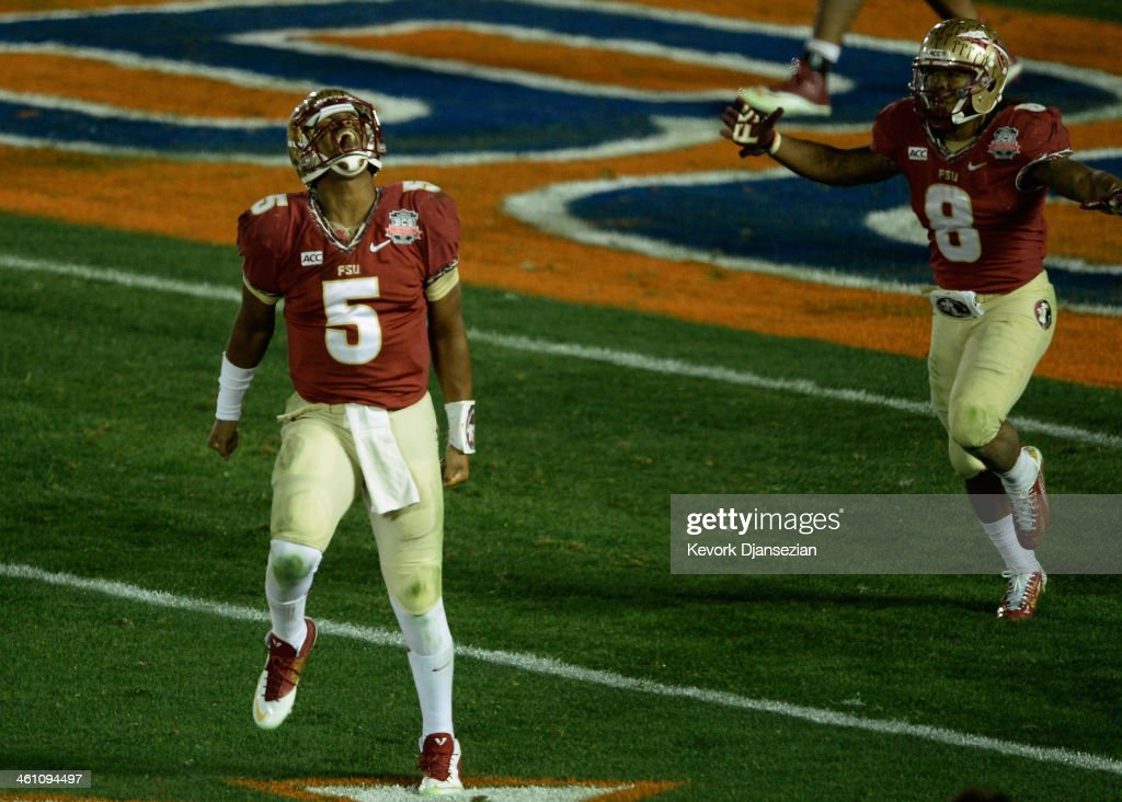 Quarterback Jameis Winston #5 of the Florida State Seminoles celebrates after a 2-yard pass for a touchdown to take a 33-31 lead over the Auburn Tigers in the final moments of the fourth quarter during the 2014 Vizio BCS National Championship Game at the Rose Bowl on January 6, 2014 in Pasadena, California. Florida State lead 34-31 after a successful extra point.