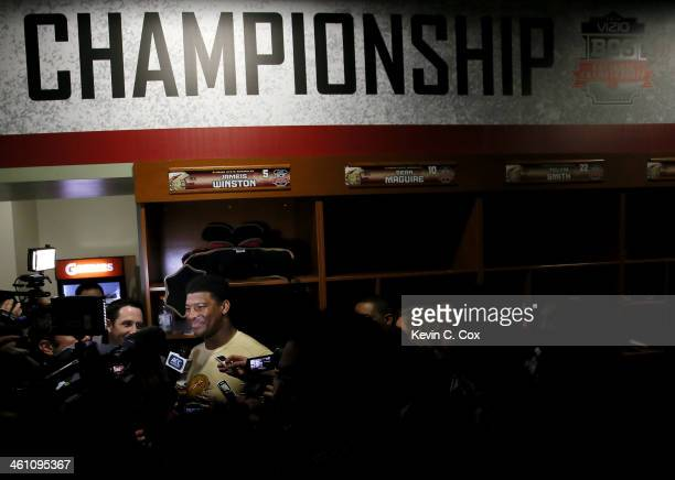 Quarterback Jameis Winston of the Florida State Seminoles celebrates in the locker room after defeating the Auburn Tigers 3431 in the 2014 Vizio BCS...