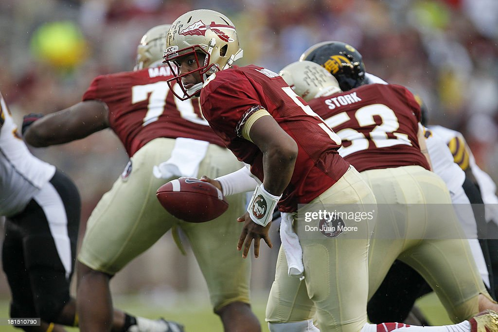 Quarterback <a gi-track='captionPersonalityLinkClicked' href=/galleries/search?phrase=Jameis+Winston&family=editorial&specificpeople=8772860 ng-click='$event.stopPropagation()'>Jameis Winston</a> #5 of the Florida State Seminoles during a running play against the Bethune-Cookman Wildcats at Doak Campbell Stadium on Bobby Bowden Field on September 21, 2013 in Tallahassee, Florida. The 8th ranked Florida State Seminoles defeated the Bethune-Cookman Wildcats 54-6.