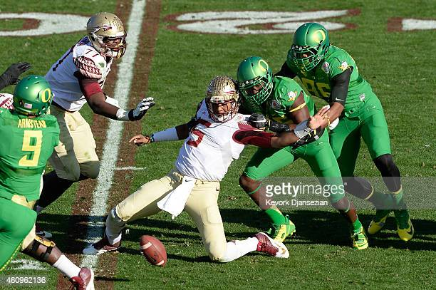 Quarterback Jameis Winston of the Florida State Seminoles fumbles the ball in the first quarter during the College Football Playoff Semifinal against...