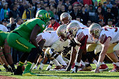 Quarterback Jameis Winston of the Florida State Seminoles goes under center against the Oregon Ducks during the College Football Playoff Semifinal at...