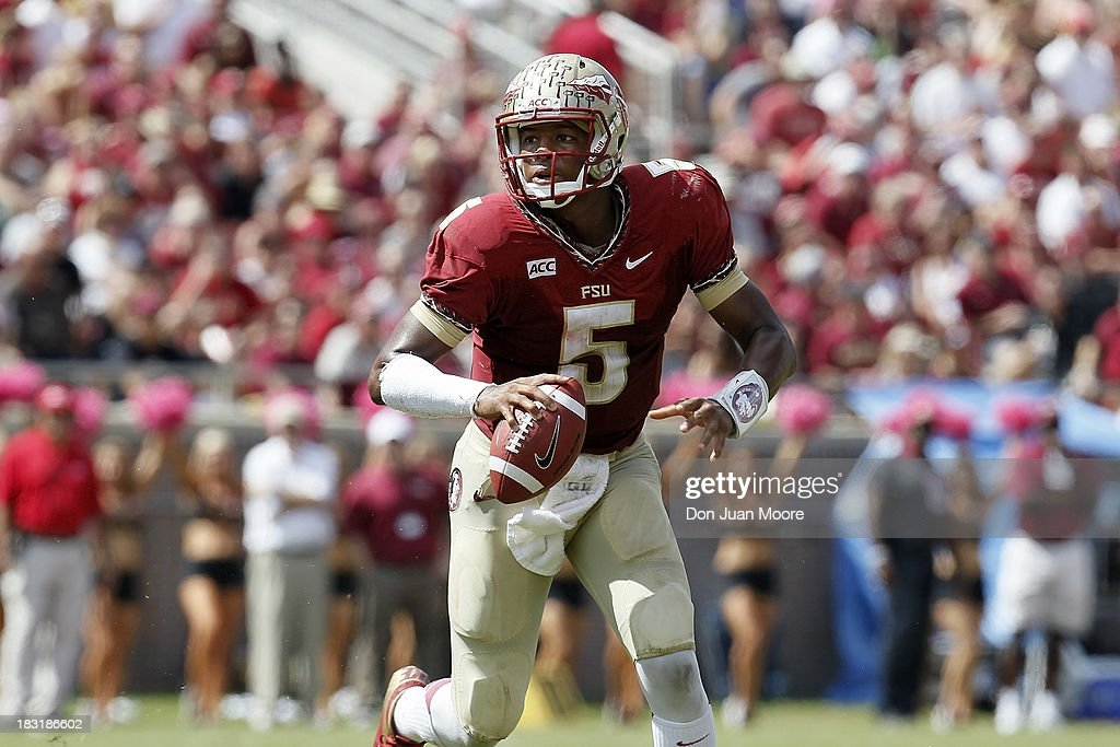 Quarterback <a gi-track='captionPersonalityLinkClicked' href=/galleries/search?phrase=Jameis+Winston&family=editorial&specificpeople=8772860 ng-click='$event.stopPropagation()'>Jameis Winston</a> #5 of the Florida State Seminoles looks to pass against the Maryland Terrapins at Doak Campbell Stadium on Bobby Bowden Field on October 5, 2013 in Tallahassee, Florida. The eightth-ranked Florida State Seminoles defeated the 25th-ranked Maryland Terrapins 63-0.