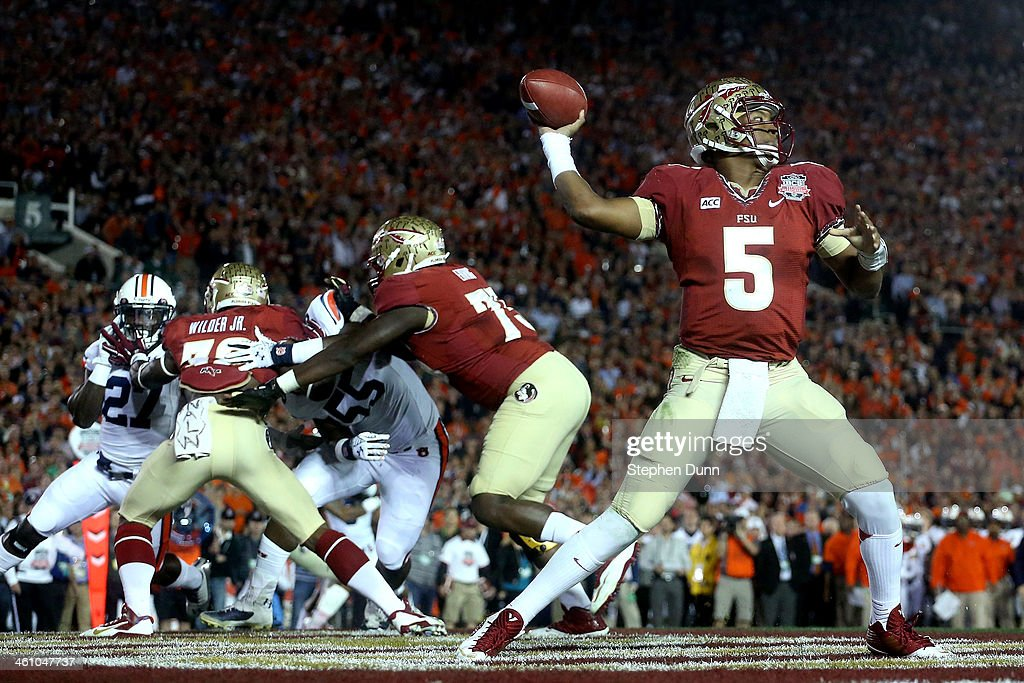 Quarterback Jameis Winston of the Florida State Seminoles looks to pass from his own endzone during the 2014 Vizio BCS National Championship Game at...