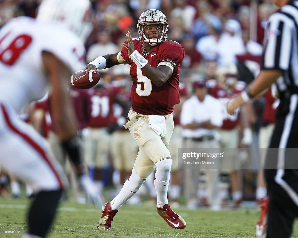 Quarterback <a gi-track='captionPersonalityLinkClicked' href=/galleries/search?phrase=Jameis+Winston&family=editorial&specificpeople=8772860 ng-click='$event.stopPropagation()'>Jameis Winston</a> #5 of the Florida State Seminoles makes a pass play during the game against North Carolina State Wolfpack at Bobby Bowden Field at Doak Campbell Stadium on October 26, 2013 in Tallahassee, Florida. The 3rd ranked Florida State Seminoles defeated North Carolina State Wolfpack 49-17.