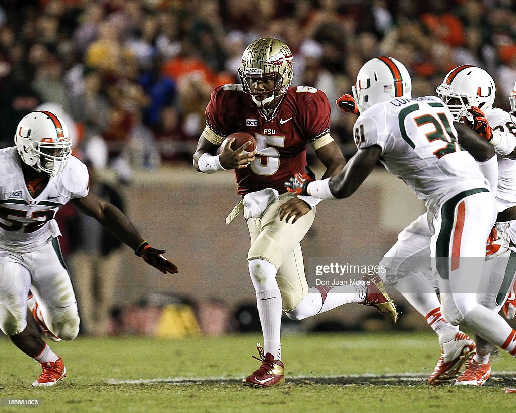 Quarterback <a gi-track='captionPersonalityLinkClicked' href=/galleries/search?phrase=Jameis+Winston&family=editorial&specificpeople=8772860 ng-click='$event.stopPropagation()'>Jameis Winston</a> #5 of the Florida State Seminoles on a running play during the game against the Miami Hurricanes at Doak Campbell Stadium on Bobby Bowden Field on November 2, 2013 in Tallahassee, Florida. 3rd ranked Florida State defeated 7th ranked Miami 41 to 14.