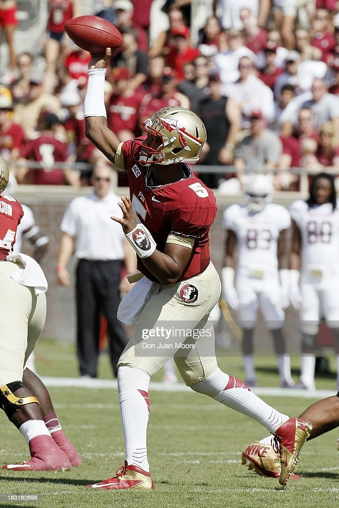 Quarterback <a gi-track='captionPersonalityLinkClicked' href=/galleries/search?phrase=Jameis+Winston&family=editorial&specificpeople=8772860 ng-click='$event.stopPropagation()'>Jameis Winston</a> #5 of the Florida State Seminoles passes against the Maryland Terrapins at Doak Campbell Stadium on Bobby Bowden Field on October 5, 2013 in Tallahassee, Florida. The eightth-ranked Florida State Seminoles defeated the 25th-ranked Maryland Terrapins 63-0.