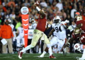 Quarterback Jameis Winston of the Florida State Seminoles passes the ball in the fourth quarter as defensive end Nosa Eguae of the Auburn Tigers...