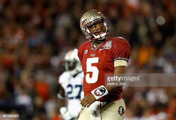 Quarterback Jameis Winston of the Florida State Seminoles reacts to a play against the Auburn Tigers during the 2014 Vizio BCS National Championship...