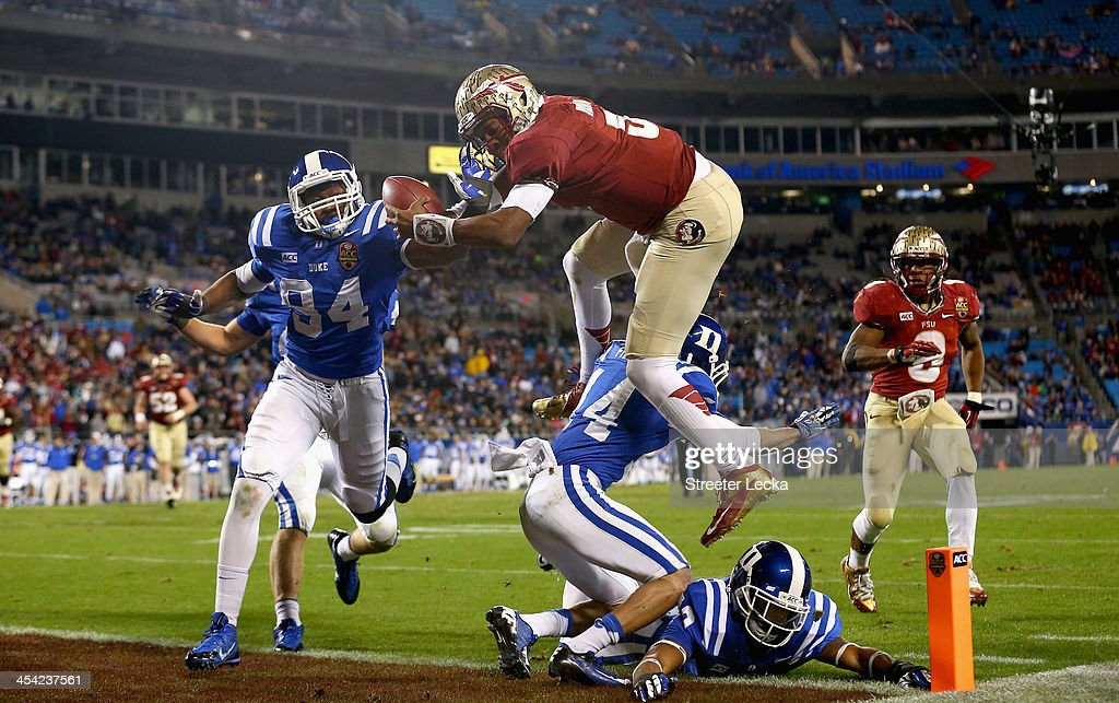 Quarterback <a gi-track='captionPersonalityLinkClicked' href=/galleries/search?phrase=Jameis+Winston&family=editorial&specificpeople=8772860 ng-click='$event.stopPropagation()'>Jameis Winston</a> #5 of the Florida State Seminoles scores a touchdown in the third quarter against the Duke Blue Devils during the ACC Championship game at Bank of America Stadium on December 7, 2013 in Charlotte, North Carolina.