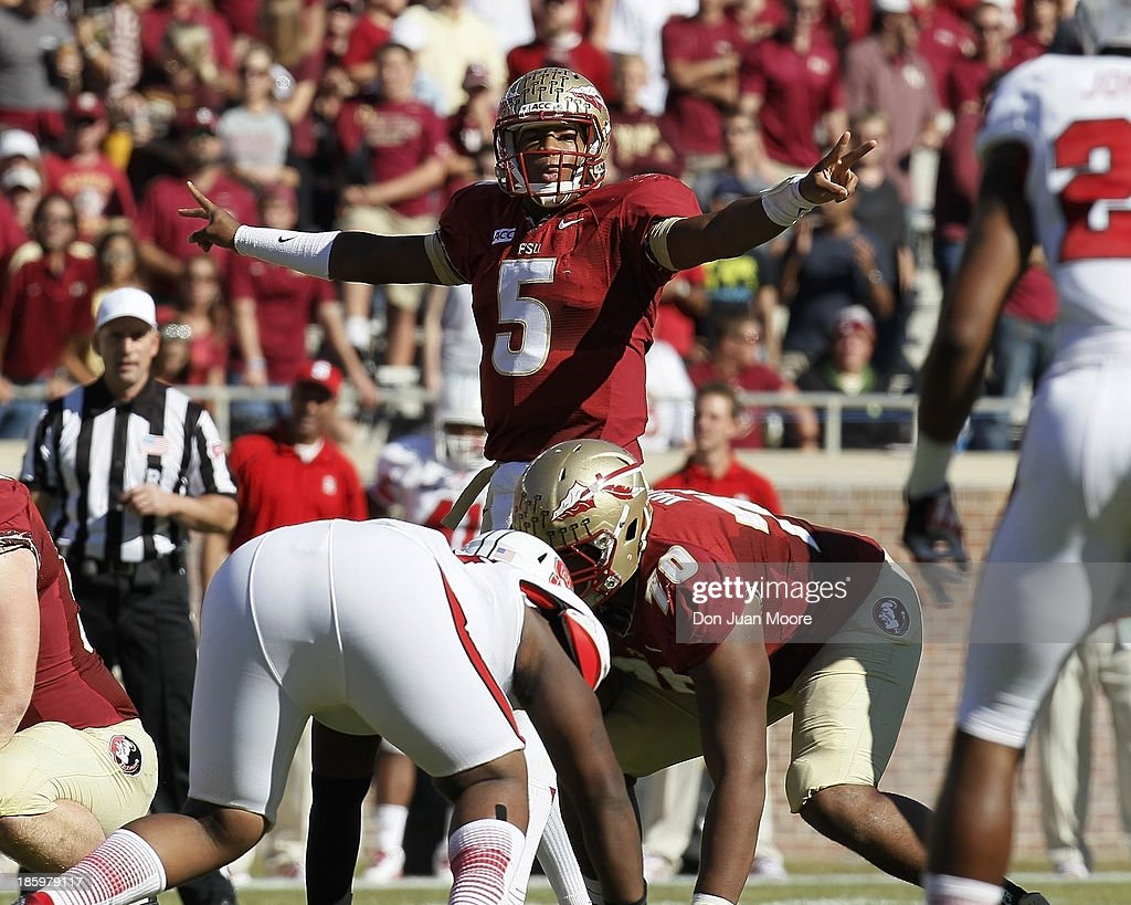 Quarterback <a gi-track='captionPersonalityLinkClicked' href=/galleries/search?phrase=Jameis+Winston&family=editorial&specificpeople=8772860 ng-click='$event.stopPropagation()'>Jameis Winston</a> #5 of the Florida State Seminoles signals a play during the game against North Carolina State Wolfpack at Bobby Bowden Field at Doak Campbell Stadium on October 26, 2013 in Tallahassee, Florida. The 3rd ranked Florida State Seminoles defeated North Carolina State Wolfpack 49-17.