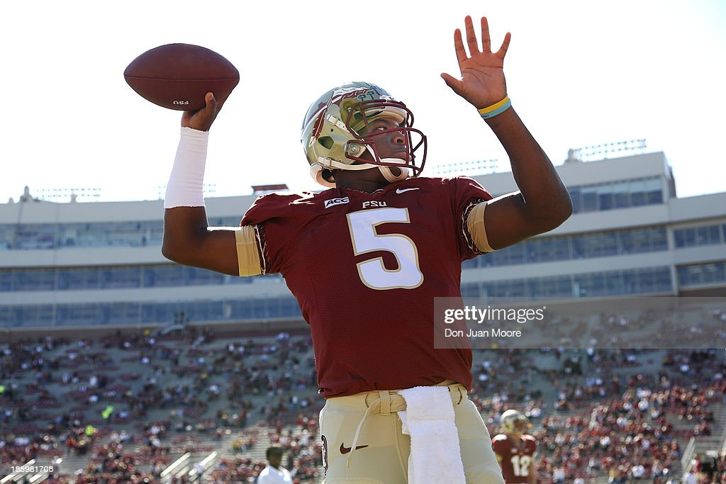 Quarterback <a gi-track='captionPersonalityLinkClicked' href=/galleries/search?phrase=Jameis+Winston&family=editorial&specificpeople=8772860 ng-click='$event.stopPropagation()'>Jameis Winston</a> #5 of the Florida State Seminoles warms up before the game against North Carolina State Wolfpack at Bobby Bowden Field at Doak Campbell Stadium on October 26, 2013 in Tallahassee, Florida. The 3rd ranked Florida State Seminoles defeated North Carolina State Wolfpack 49-17.