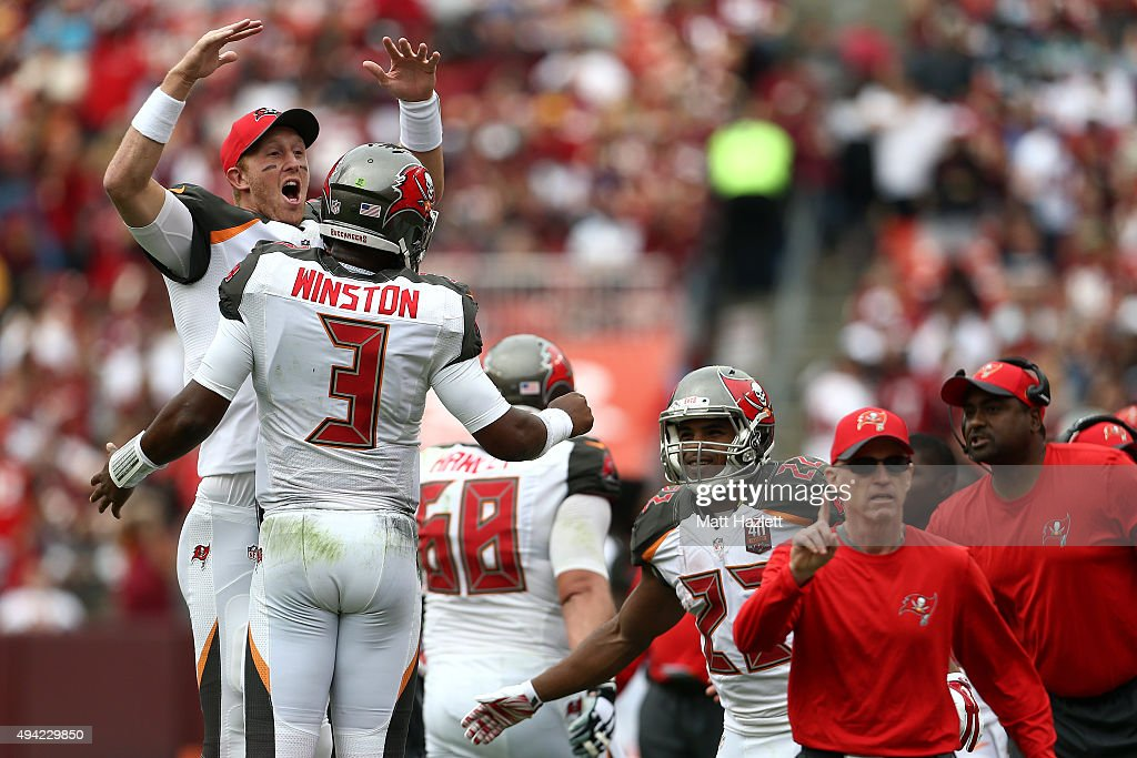 Quarterback <a gi-track='captionPersonalityLinkClicked' href=/galleries/search?phrase=Jameis+Winston&family=editorial&specificpeople=8772860 ng-click='$event.stopPropagation()'>Jameis Winston</a> #3 of the Tampa Bay Buccaneers celebrates with quarterback <a gi-track='captionPersonalityLinkClicked' href=/galleries/search?phrase=Mike+Glennon+-+American+football-speler&family=editorial&specificpeople=11404080 ng-click='$event.stopPropagation()'>Mike Glennon</a> #8 of the Tampa Bay Buccaneers after throwing a second quarter touchdown during a game against the Washington Redskins at FedExField on October 25, 2015 in Landover, Maryland.