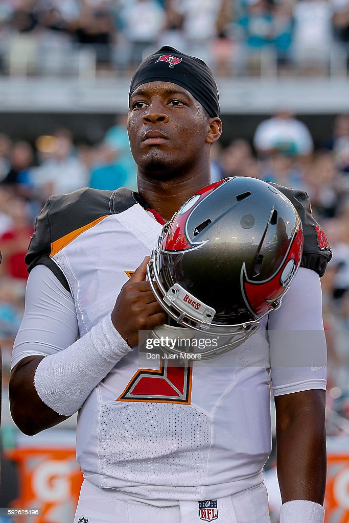 Quarterback Jameis Winston #3 of the Tampa Bay Buccaneers during the national anthem before the start of a preseason game against the Jacksonville Jaguars at EverBank Field on August 20, 2016 in Jacksonville, Florida. The Bucs defeated the Jags 27 to 21.