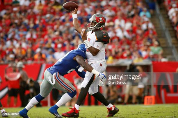 Quarterback Jameis Winston of the Tampa Bay Buccaneers is hit by strong safety Landon Collins of the New York Giants as he realize the ball during...