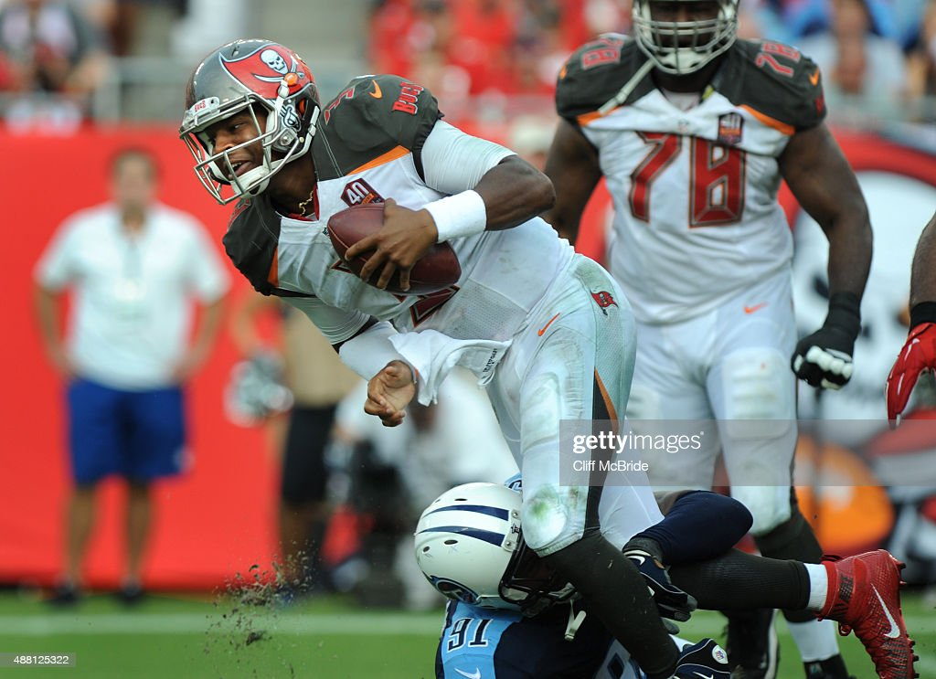 Quarterback Jameis Winston #3 of the Tampa Bay Buccaneers is sacked by outside linebacker Derrick Morgan #91 of the Tennessee Titans in the fourth quarter at Raymond James Stadium on September 13, 2015 in Tampa, Florida.