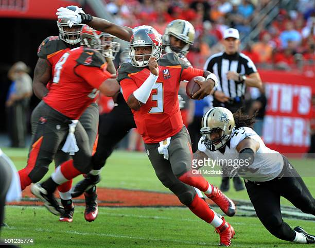 Quarterback Jameis Winston of the Tampa Bay Buccaneers scrambles for a big gain in the second quarter against the New Orleans Saints at Raymond James...