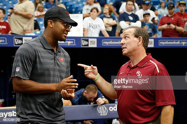 Quarterback Jameis Winston of the Tampa Bay Buccaneers speaks with his former coach head football coach Jimbo Fisher of Florida State University just...