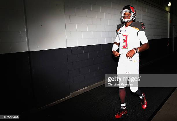 Quarterback Jameis Winston of the Tampa Bay Buccaneers walks out onto the field before the NFL game against the Arizona Cardinals at the University...