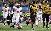 Quarterback James Franklin of the Missouri Tigers runs the ball for 16yards against Lyndell Johnson of the Oklahoma State Cowboys in the second...