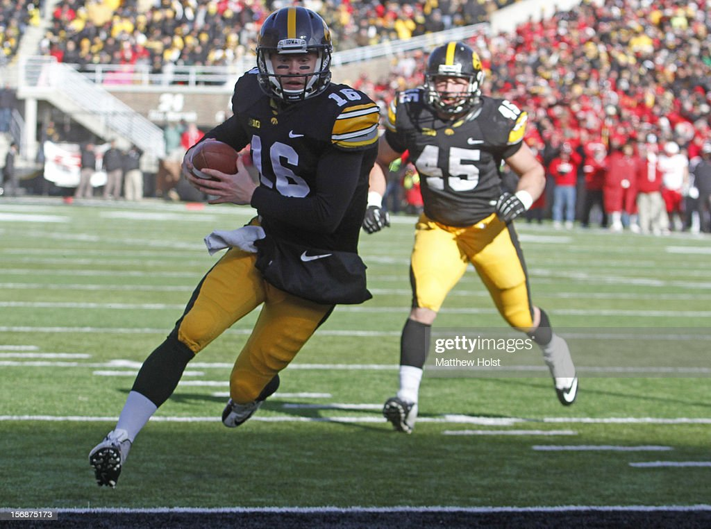 Quarterback James Vandenberg #16 of the Iowa Hawkeyes rushes for a touchdown during the first quarter on a keeper against the Nebraska Cornhuskers on November 23, 2012 at Kinnick Stadium in Iowa City, Iowa. Iowa lead Nebraska 7-3 at the half.
