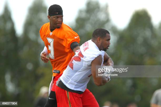 Quarterback Jamies Winston hands the ball off to runningback Doug Martin during the Tampa Bay Buccaneers Minicamp on June 14 2017 at One Buccaneer...