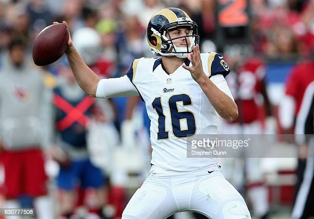 Quarterback Jared Goff of the Los Angeles Rams throws a pass against the Arizona Cardinals in the third quarter at Los Angeles Memorial Coliseum on...