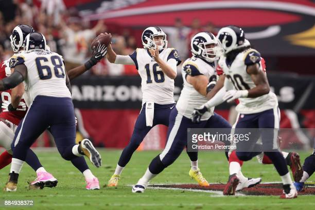 Quarterback Jared Goff of the Los Angeles Rams throws a pass during the first half of the NFL game against the Arizona Cardinals at the University of...