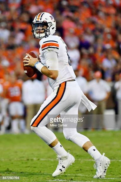 Quarterback Jarrett Stidham of the Auburn Tigers drops back to pass against the Clemson Tigers during the football game at Memorial Stadium on...