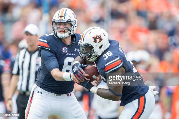 Quarterback Jarrett Stidham of the Auburn Tigers hands the ball off to running back Kamryn Pettway of the Auburn Tigers during their game against the...