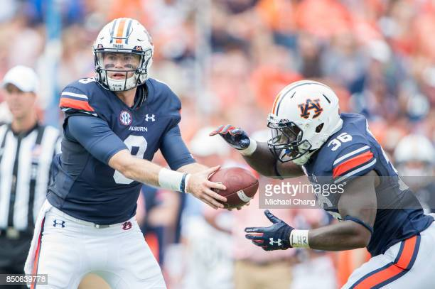 Quarterback Jarrett Stidham of the Auburn Tigers looks to hand the ball off to running back Kamryn Pettway of the Auburn Tigers during their game...