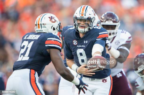 Quarterback Jarrett Stidham of the Auburn Tigers looks to hand the ball off to running back Kerryon Johnson of the Auburn Tigers during their game...