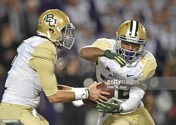 Quarterback Jarrett Stidham of the Baylor Bears fakes a handoff to running back Shock Linwood against the Kansas State Wildcats during the second...