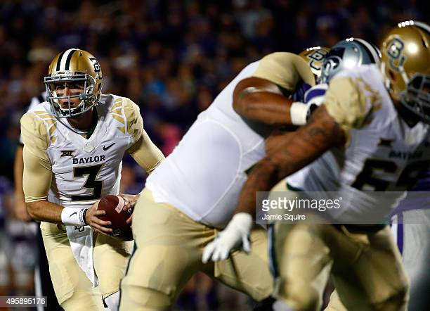 Quarterback Jarrett Stidham of the Baylor Bears looks to pass during the 1st quarter of the game against the Kansas State Wildcats at Bill Snyder...