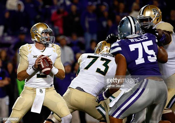 Quarterback Jarrett Stidham of the Baylor Bears looks to pass during the 2nd half of the game against the Kansas State Wildcats at Bill Snyder Family...