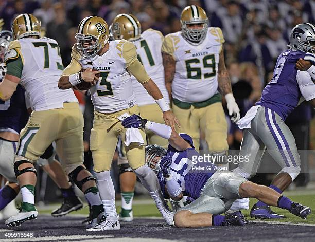 Quarterback Jarrett Stidham of the Baylor Bears rushes into the end zone for a touchdown against the Kansas State Wildcats during the first half on...