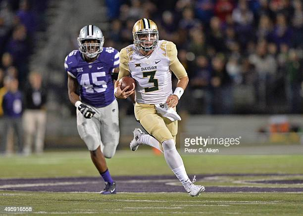 Quarterback Jarrett Stidham of the Baylor Bears rushes up field past defensive end Marquel Bryant of the Kansas State Wildcats during the first half...