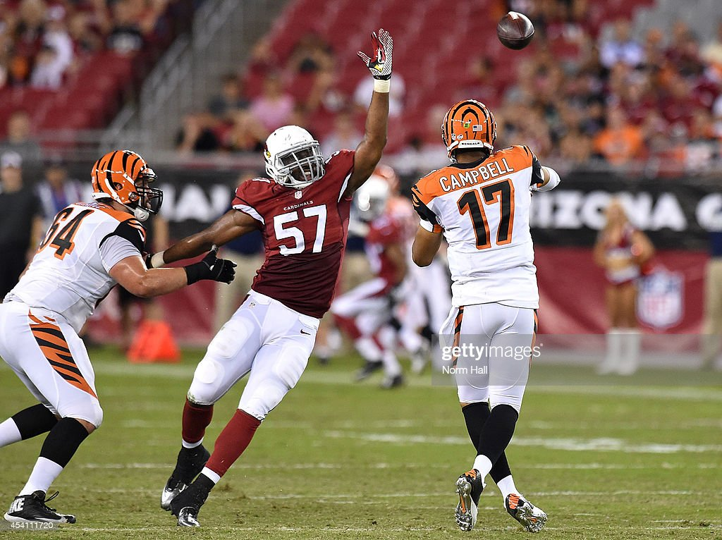 Quarterback Jason Campbell #17 of the Cincinnati Bengals throws past linebacker <a gi-track='captionPersonalityLinkClicked' href=/galleries/search?phrase=Alex+Okafor&family=editorial&specificpeople=6235407 ng-click='$event.stopPropagation()'>Alex Okafor</a> #17 of the Arizona Cardinals during the preseason NFL game at University of Phoenix Stadium on August 24, 2014 in Glendale, Arizona.