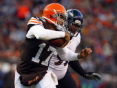 Quarterback Jason Campbell of the Cleveland Browns runs by nose tackle Haloti Ngata of the Baltimore Ravens at FirstEnergy Stadium on November 3 2013...