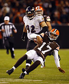 Quarterback Jason Campbell of the Cleveland Browns slides in front of nose tackle Haloti Ngata of the Baltimore Ravens at FirstEnergy Stadium on...