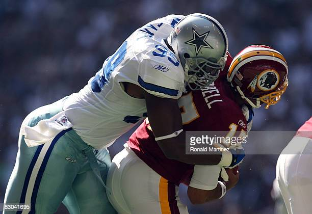 Quarterback Jason Campbell of the Washington Redskins is sacked by Chris Canty of the Dallas Cowboys at Texas Stadium on September 28 2008 in Irving...
