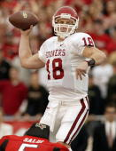 Quarterback Jason White of the Oklahoma Sooners drops back to pass against the Texas Tech Red Raiders on November 22 2003 at Jones SBC Stadium in...