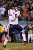 Quarterback Jay Cutler of the Chicago Bears celebrates after throwing a touchdown pass to Earl Bennett during the fourth quarter of the game at...