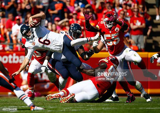 Quarterback Jay Cutler of the Chicago Bears is upended as while scrambling during the 2nd half of the game against the Kansas City Chiefs at...