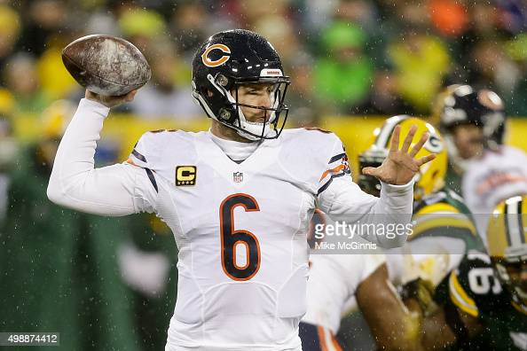 Quarterback Jay Cutler of the Chicago Bears looks to pass in the first quarter against the Green Bay Packers at Lambeau Field on November 26 2015 in...