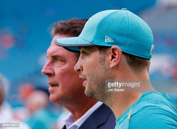 Quarterback Jay Cutler of the Miami Dolphins right stands with former Dolphins quarterback Dan Marino before the Dolphins played a preseason game...